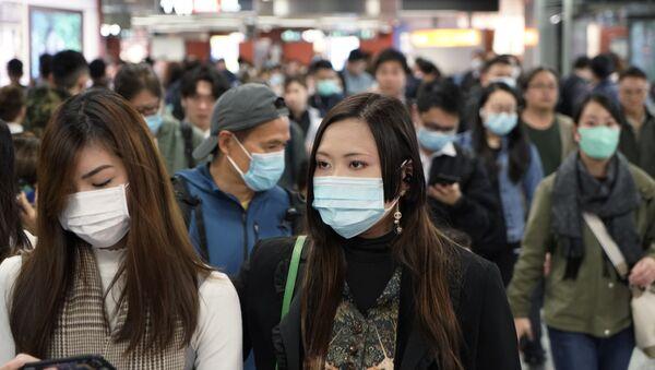 Los chinos llevan máscaras para no contagiarse - Sputnik Mundo