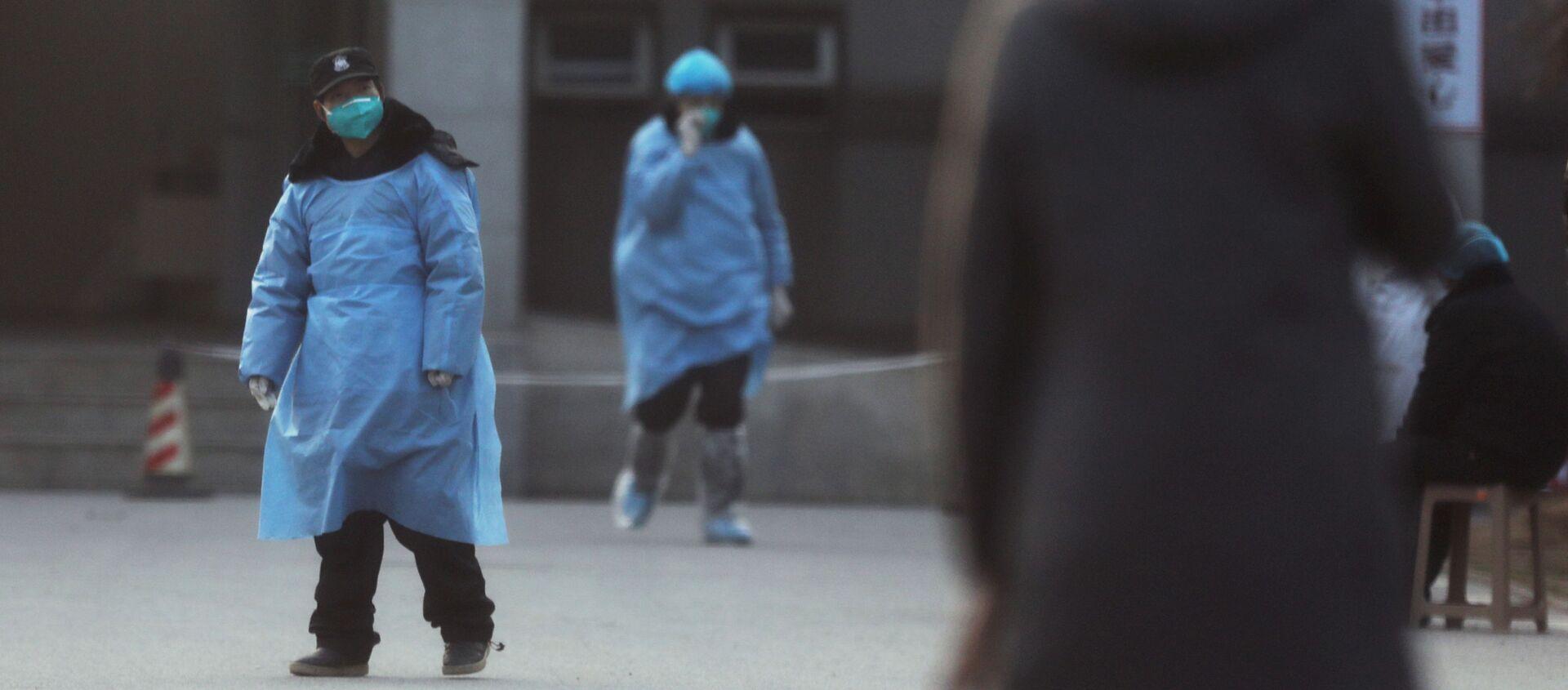 Personal de seguridad en Wuhan, China - Sputnik Mundo, 1920, 04.02.2021