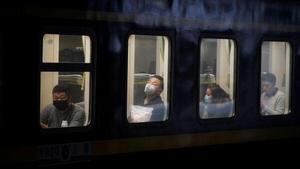 Un tren en China - Sputnik Mundo