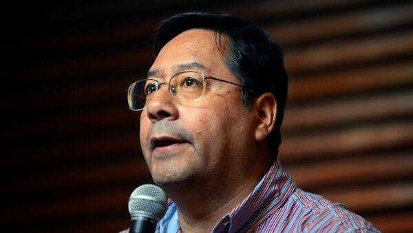 Luis Arce, candidato presidencial del Movimiento Al Socialismo (MAS) de Bolivia - Sputnik Mundo