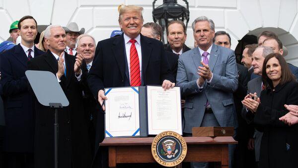 Donald Trump, presidente de EEUU, en la ceremonia de la firma del acuerdo comercial entre México, EEUU y Canadá (T-MEC)  - Sputnik Mundo