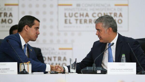 El opositor venezolano, Juan Guaidó, y el presidente de Colombia, Iván Duque - Sputnik Mundo