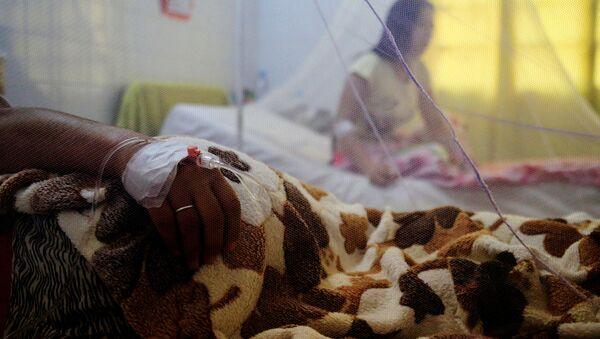 Un paciente con dengue en Asunción - Sputnik Mundo
