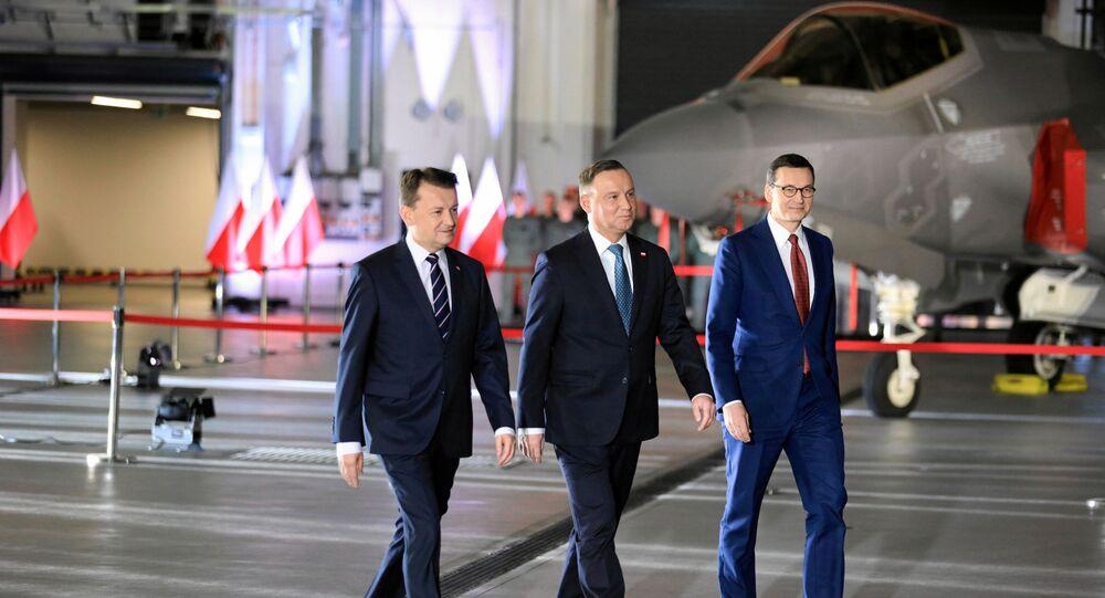El ministro de Defensa polaco, Mariusz Blaszczak, el presidente, Andrzej Duda, y el primer ministro, Mateusz Morawiecki