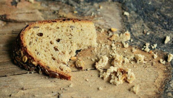 Un pedazo de pan (imagen referencial) - Sputnik Mundo