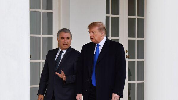 El presidente de Colombia, Iván Duque, junto a su homólogo estadounidense, Donald Trump - Sputnik Mundo