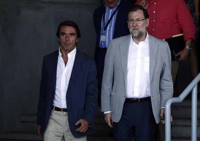 Los expresidentes del Gobierno español José María Aznar y Mariano Rajoy