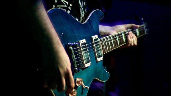 Una guitarra eléctrica - Sputnik Mundo