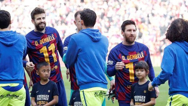 Los jugadores del Barcelona, Gerard Piqué y Lionel Messi - Sputnik Mundo