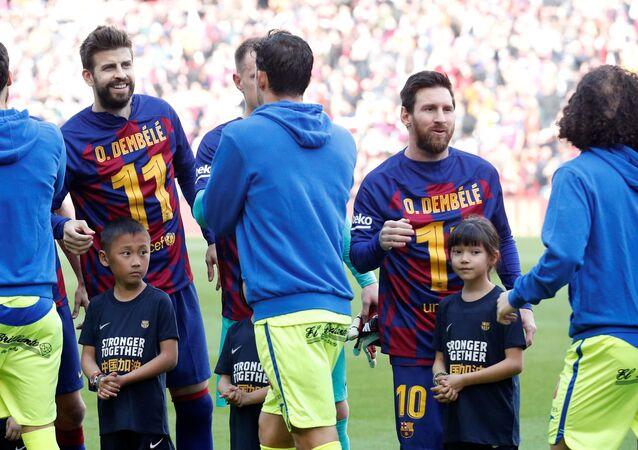 Los jugadores del Barcelona, Gerard Piqué y Lionel Messi