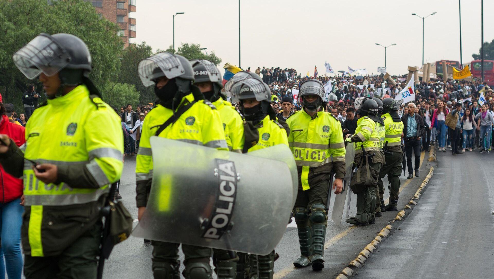 Efectivos de la Policía de Colombia. Imagen referencial - Sputnik Mundo, 1920, 22.12.2020