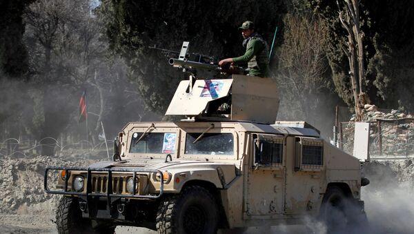 Un vehículo blindado en Afganistán - Sputnik Mundo
