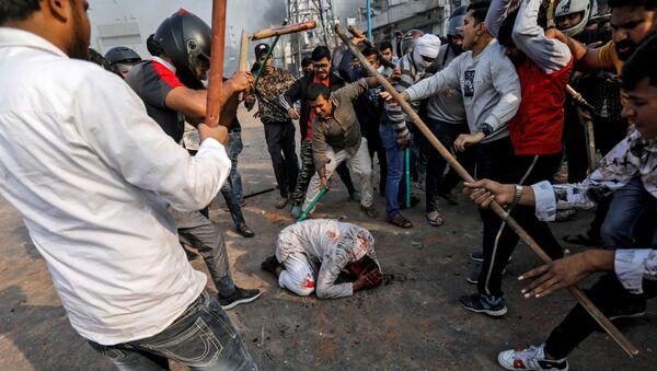 Los disturbios en Nueva Delhi - Sputnik Mundo