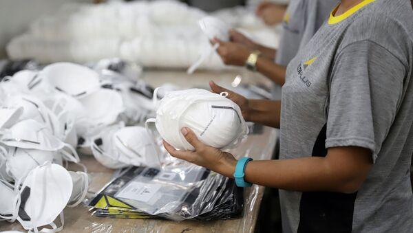 Producción de mascarillas - Sputnik Mundo