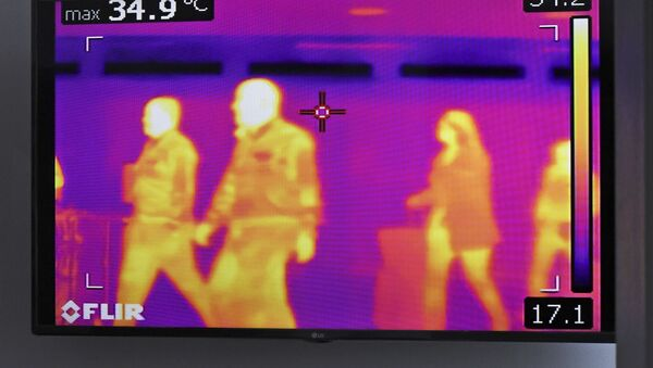 Cámara térmica para detectar personas con coronavirus - Sputnik Mundo