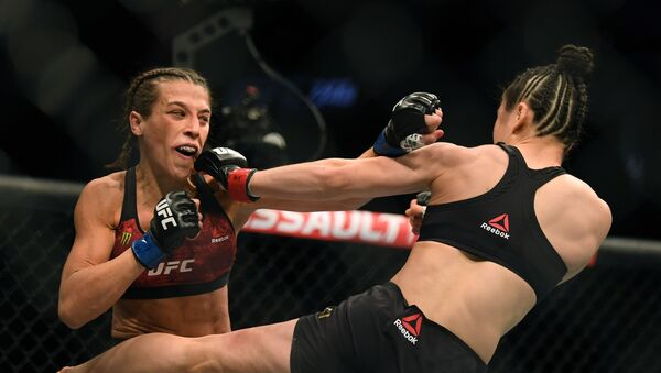 La pelea entre Joanna Jedrzejczyk y Weili Zhang - Sputnik Mundo