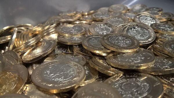 Pesos mexicanos. Monedas. Imagen referencial - Sputnik Mundo