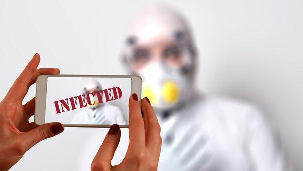 Teléfono móvil infectado por el coronavirus - Sputnik Mundo