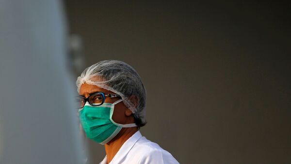 Una médico en Brasilia, Brasil - Sputnik Mundo