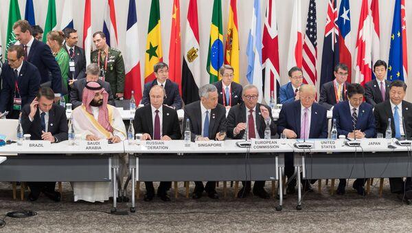 Presidentes durante una cumbre del G20 - Sputnik Mundo