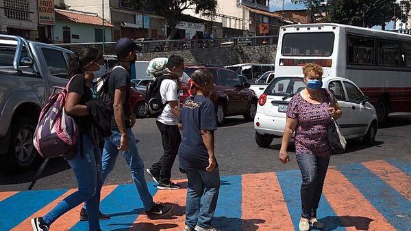 La gente en las calles de Caracas, Venezuela - Sputnik Mundo
