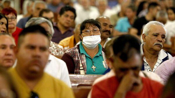 Ciudadanos mexicanos se protegen del coronavirus - Sputnik Mundo