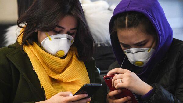 Mujeres en mascarillas (imagen referencial) - Sputnik Mundo