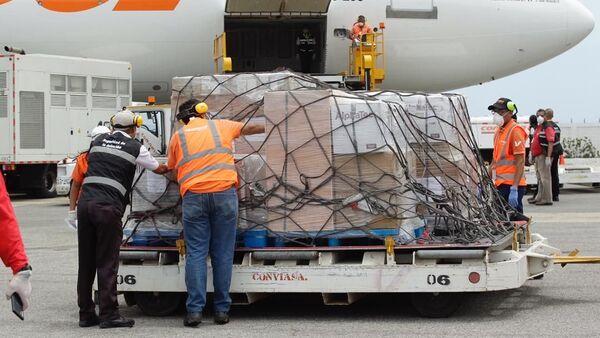 La llegada de la ayuda humanitaria de República Popular China para combatir el virus COVID-19 - Sputnik Mundo