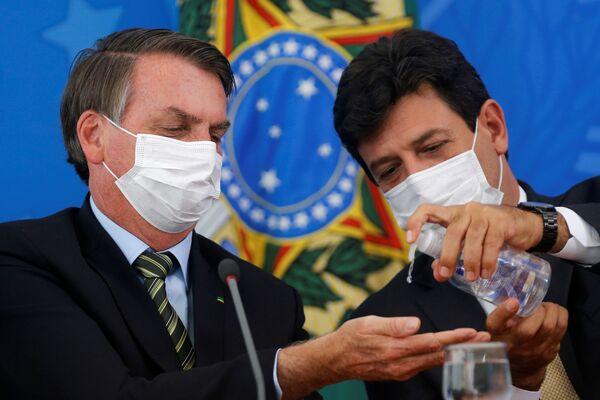 Las fotos más impactantes de la semana: el coronavirus captado en instantáneas   - Sputnik Mundo