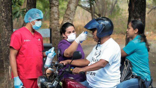 Revisión de la gente en Nicaragua para detescar si tienen coronavirus - Sputnik Mundo