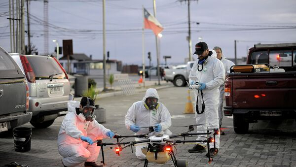 Desinfección de las calles en Chile - Sputnik Mundo