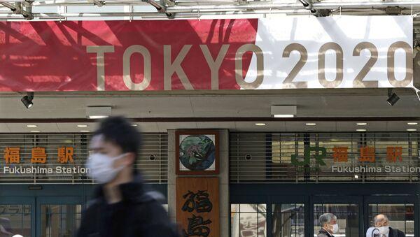 Un letrero de Tokio 2020 en Fukushima, Japón - Sputnik Mundo