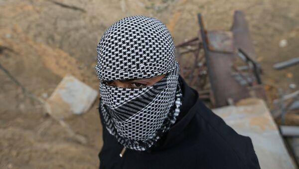 Un militante palestino - Sputnik Mundo