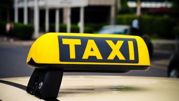 Un taxi - Sputnik Mundo