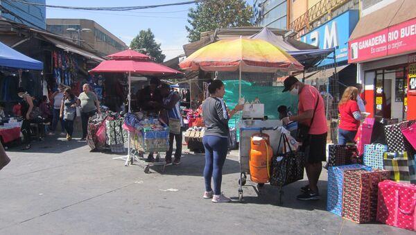 Comercio en centro de Santiago 26 marzo 2020 - Sputnik Mundo