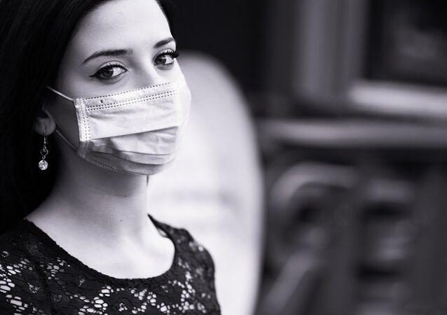 Una mujer con mascarilla (imagen referencial)