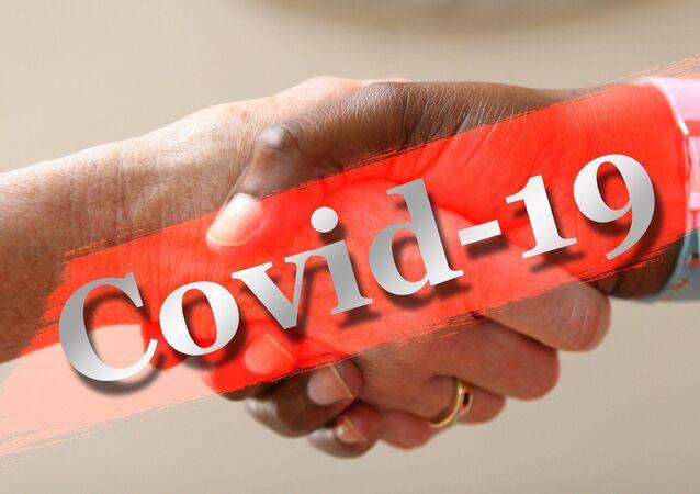 Apretón de manos durante el brote de coronavirus