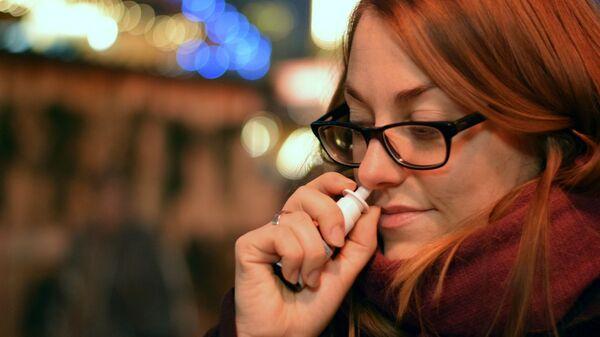 Una mujer pierde el olfato - Sputnik Mundo