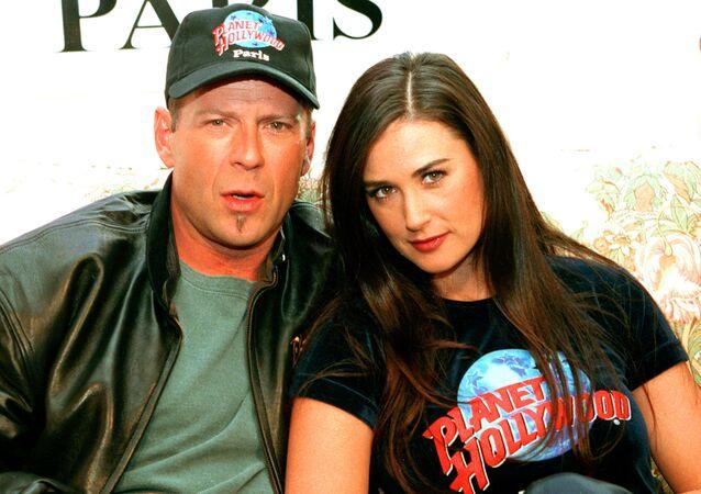 Bruce Willis y Demi Moore en 1995