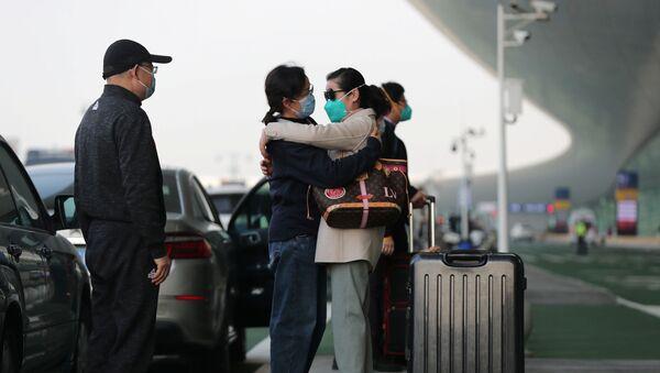 Residentes de Wuhan - Sputnik Mundo