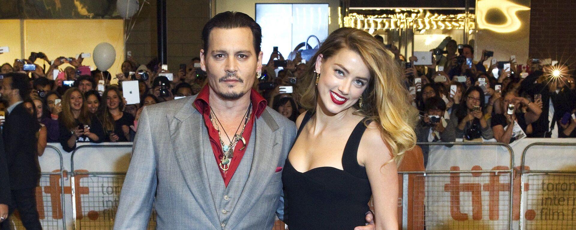 El actor Johnny Depp junto a su exesposa, la actriz Amber Heard - Sputnik Mundo, 1920, 09.04.2020