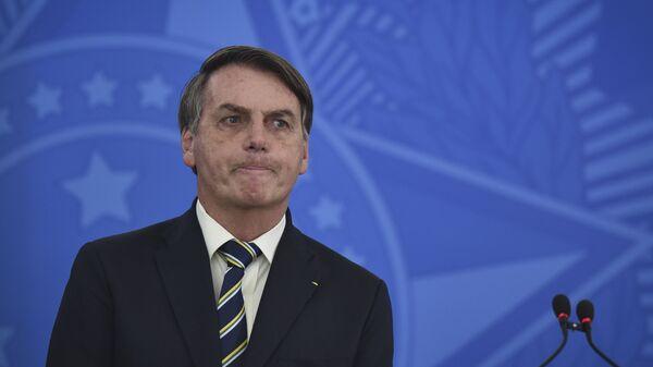 El presidente de Brasil, Jair Bolsonaro, durante una rueda de prensa - Sputnik Mundo