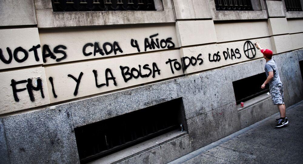 Graffiti contra el FMI en Madrid