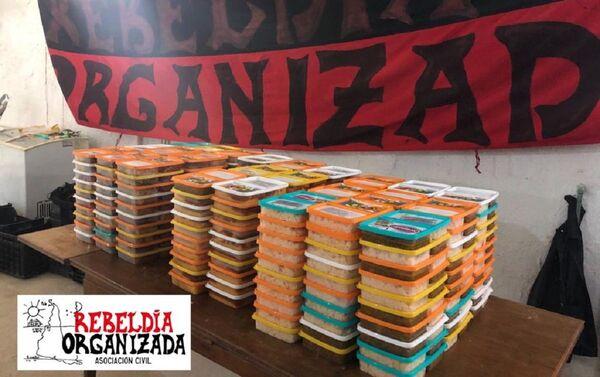 Viandas de alimentos para ser entregadas por asociación civil Rebeldía Organizada en Uruguay - Sputnik Mundo