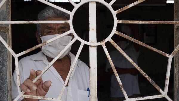Un hombre en Piura, Perú - Sputnik Mundo