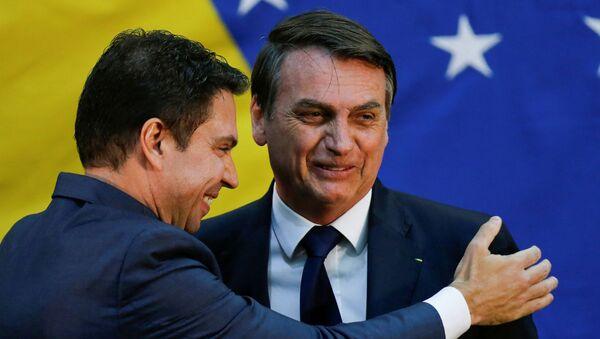 Alexandre Ramagem y Jair Bolsonaro, el presidente de Brasil - Sputnik Mundo