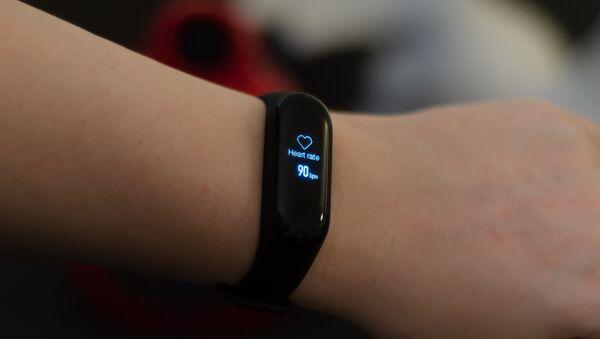 Una pulsera de Xiaomi (imagen referencial) - Sputnik Mundo