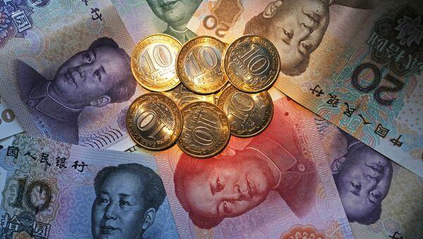 El rublo y el yuan, monedas de Rusia y China - Sputnik Mundo