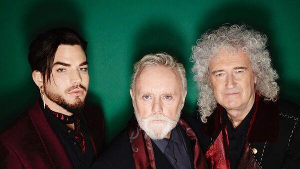 Adam Lambert junto a los integrantes de Queen - Sputnik Mundo