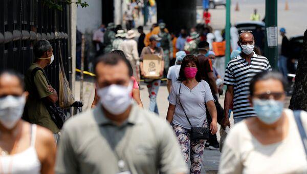 Personas en las calles de Caracas, Venezuela - Sputnik Mundo